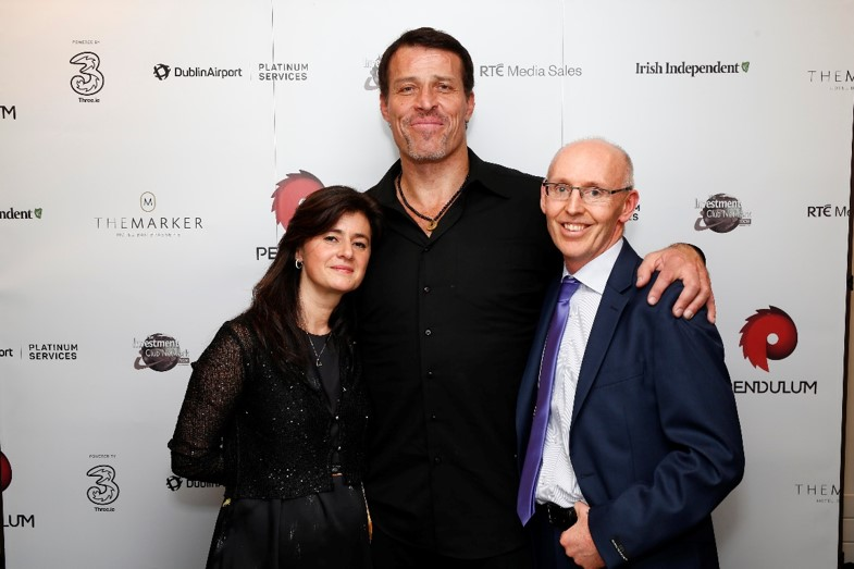 Owen and Ana presenting with Tony Robbins